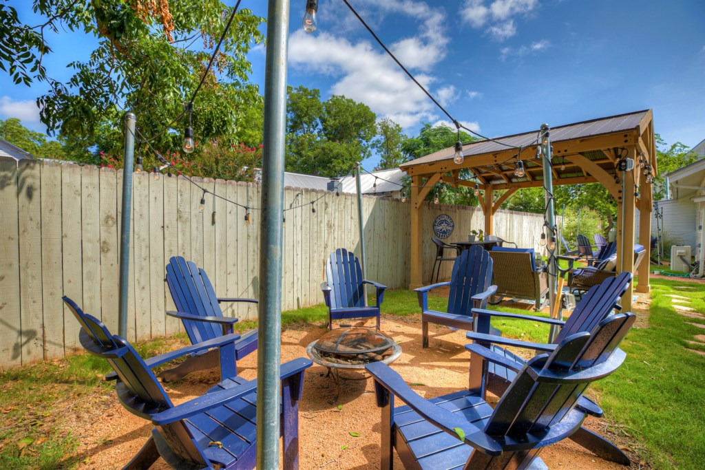 You'll love the homes outdoor spaces that include 2 firepits, grill, gazebo, and outdoor bar!
