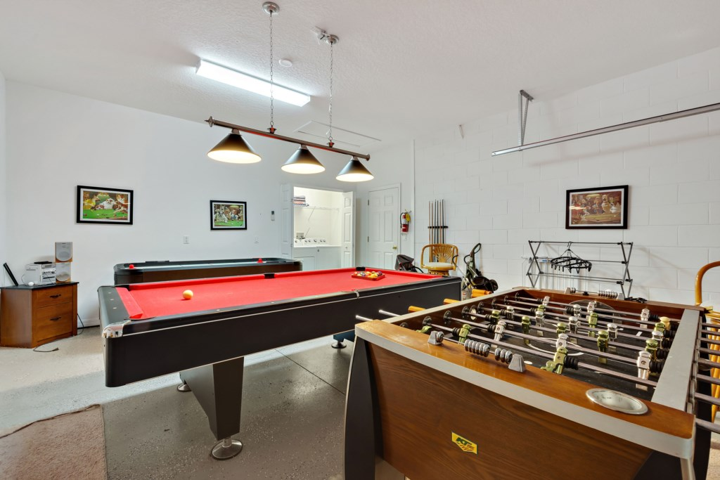 Games room with pool table and foosbal table