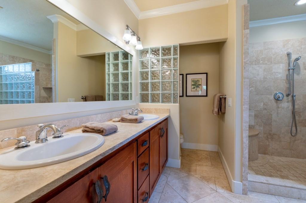 Master Bathroom with his / her sink and walk in shower