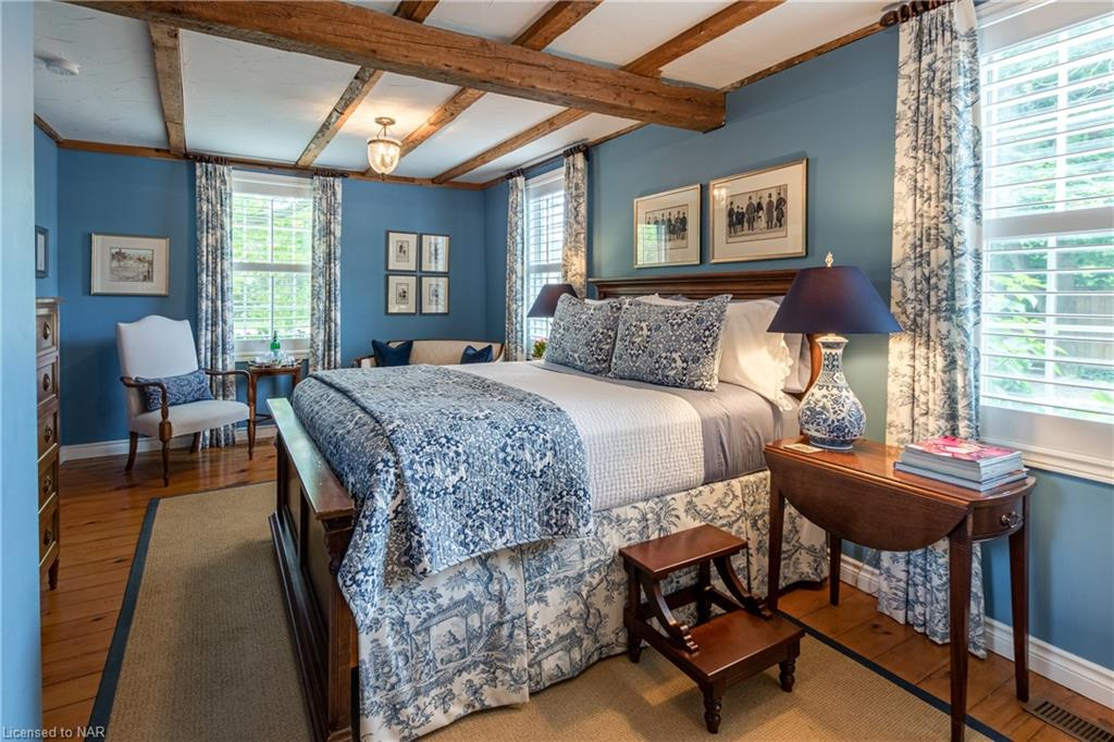 The Blue Room - main floor bedroom with Queen bed and ensuite with walk-in shower - The Butler House