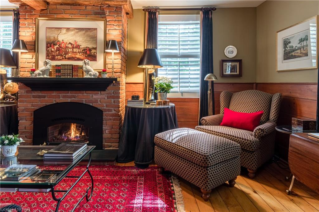 Cozy up with a good book and a glass of wine in the Living Room by the fire - Butler House Vacation