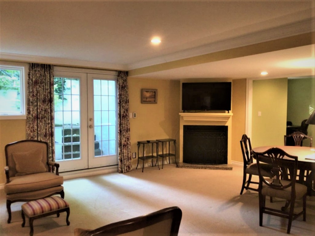 Basement family room with TV and Gas Fireplace - The Butler House - Niagara-on-the-Lake