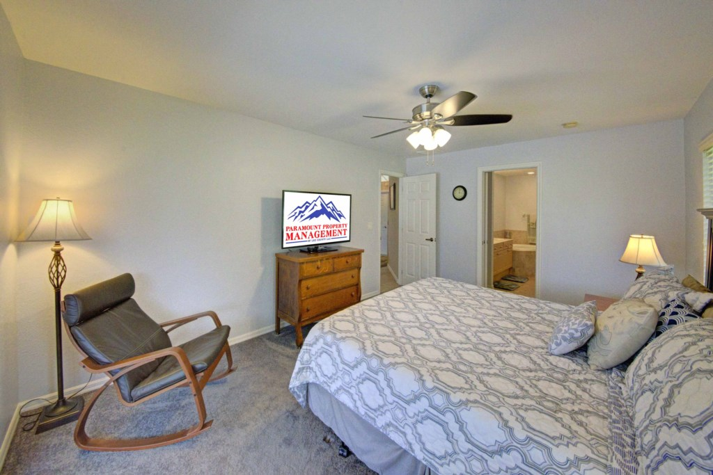 Spacious Master with ceiling fan and TV