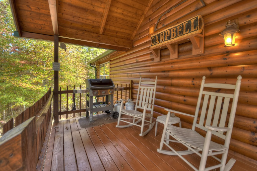 Large porch with BBQ, and rocking chairs to sit relax and take in the view