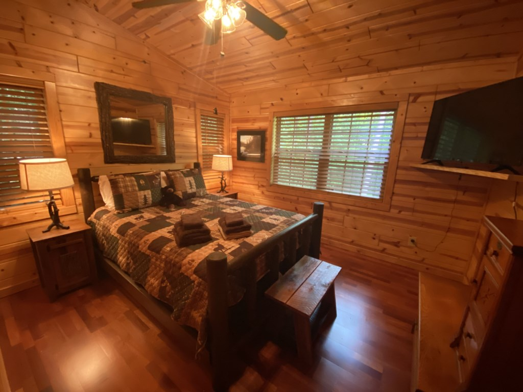 Comfortable  bedroom with ceiling fan