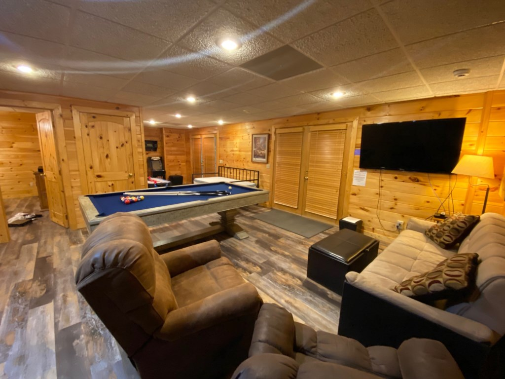 Large Game Room with TV and comfortable lounge seating