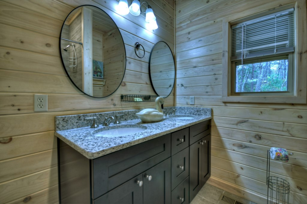 Well equipped bathroom with double vanity and ample storage