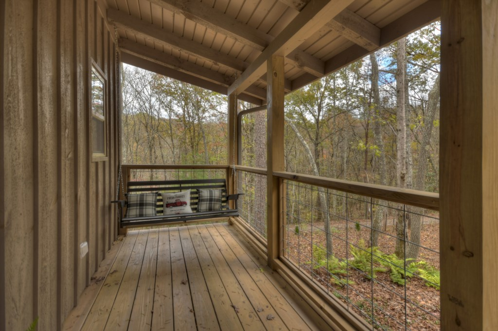 Large porch to sit back and enjoy the amazing wooded views