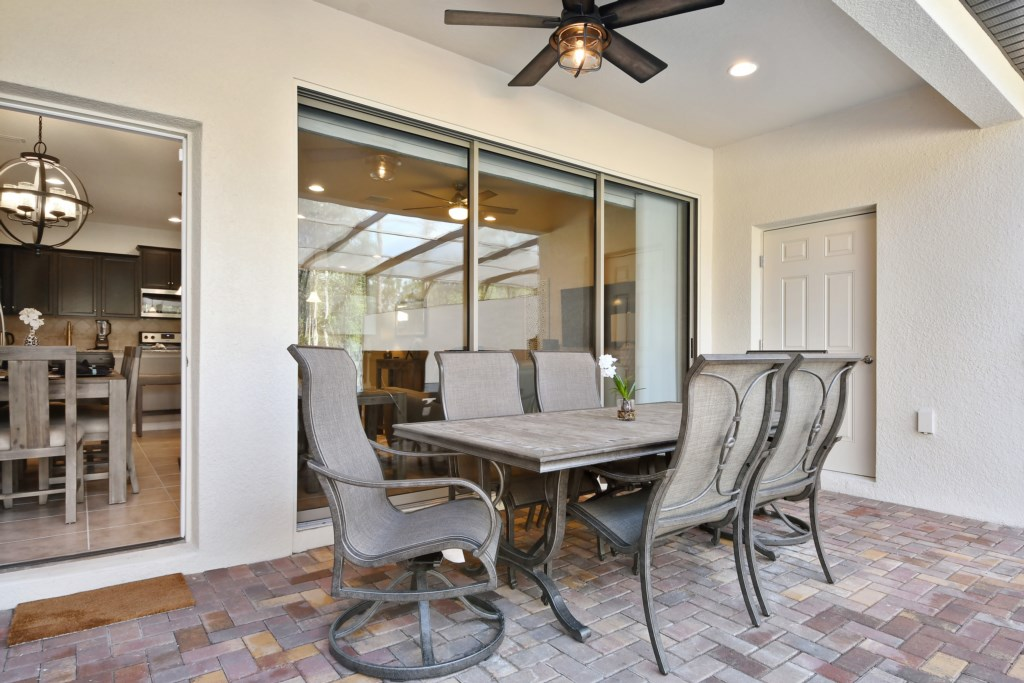 Fantastic patio furniture with sliding glass door leading to dining room and kitchen