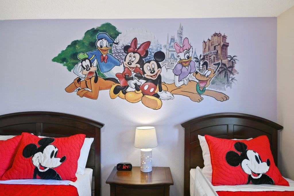 View 2 of Disney themed kids queen and twin bedroom with flat screen TV