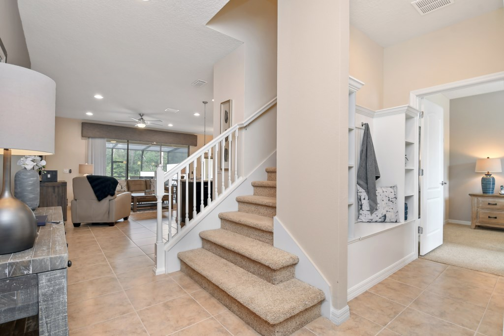 View 2 of gorgeous front entry of villa with stairs, living room, and storage