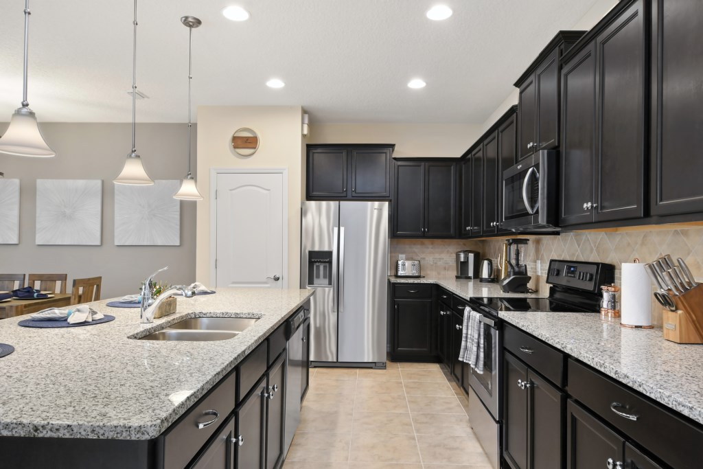 View 3 of stunning modern style kitchen with microwave, stove, and oven
