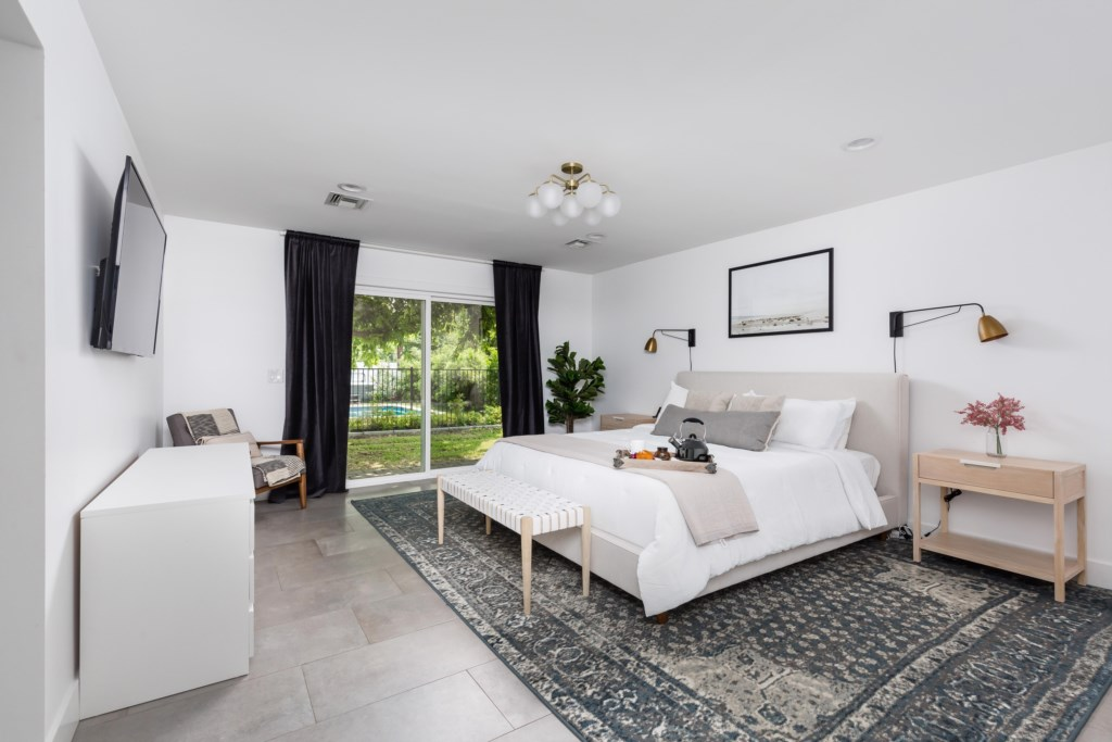 Master Bedroom with King Bed, large flat screen TV and en-suite bathroom