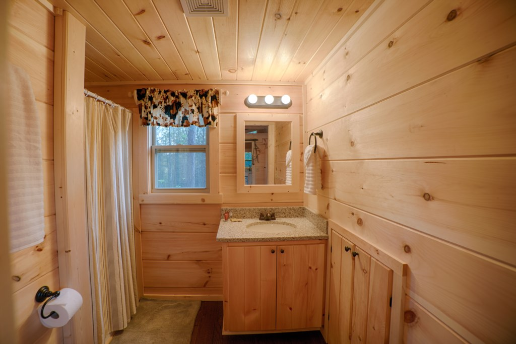 Bath with shower in Cabins A & E