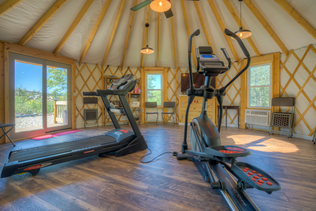 Treadmill and elliptical in the yurt.