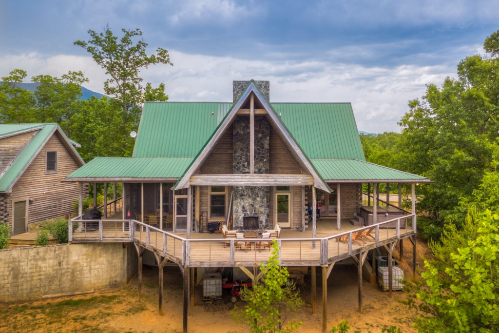 Amazing shot of back of house showing deck and  hot tub area