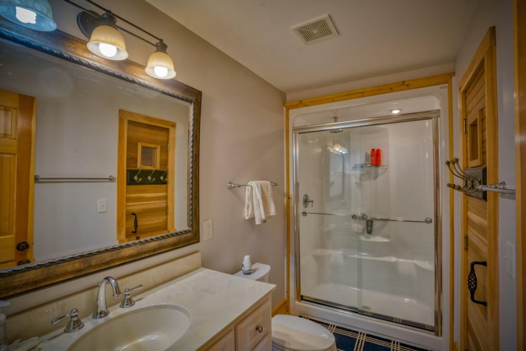 Spacious bathroom with shower and Sauna