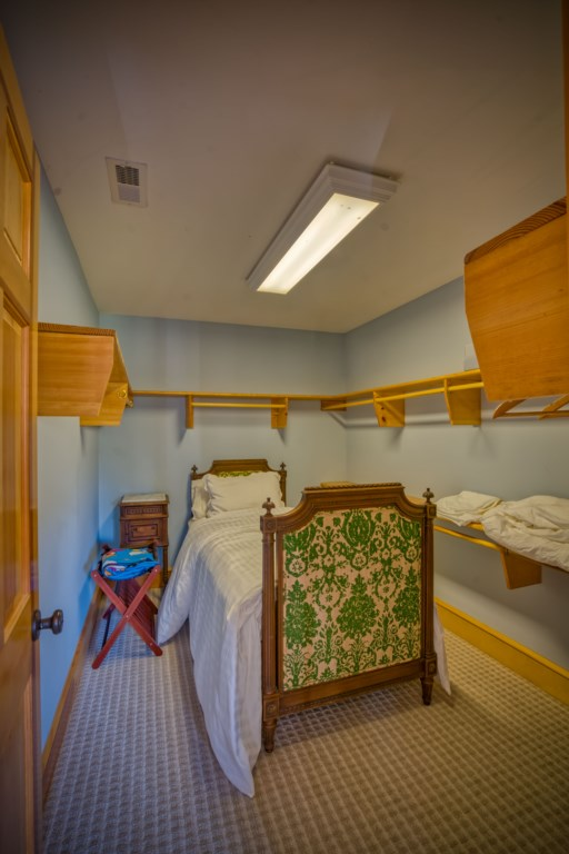 Extra bed in spacious closet downstairs