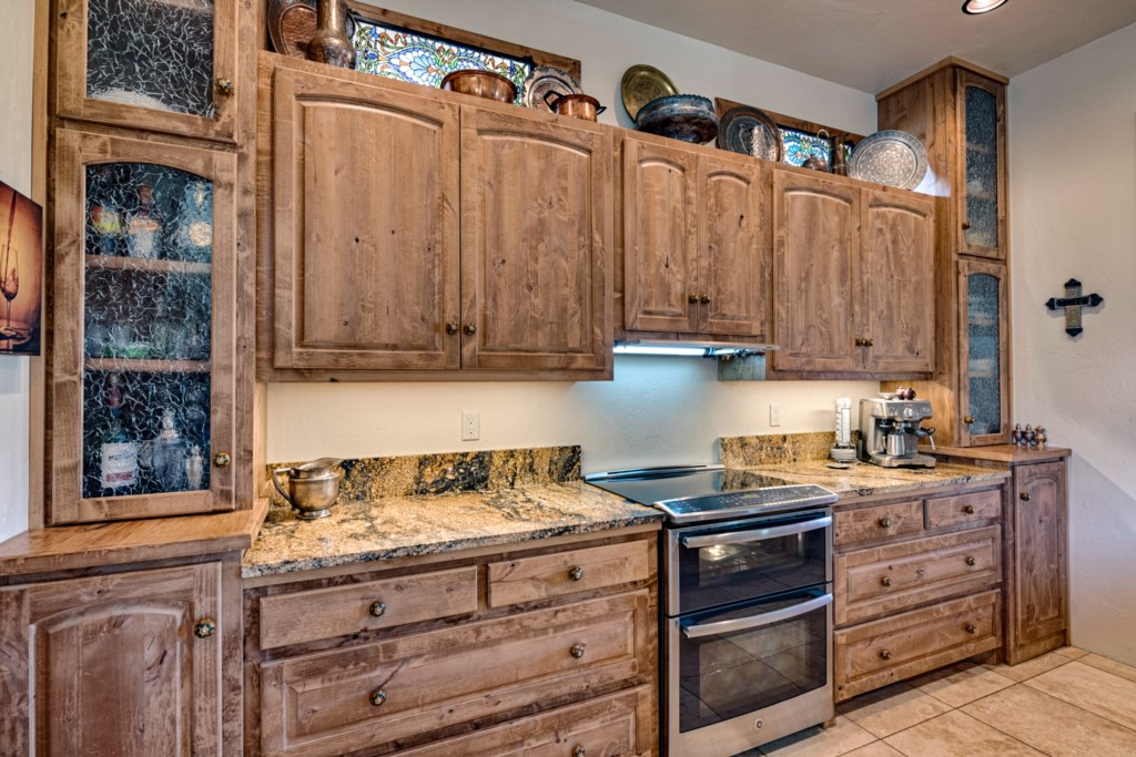 Beautiful Wood Cabinets, Granite Counters, and Tile Floors