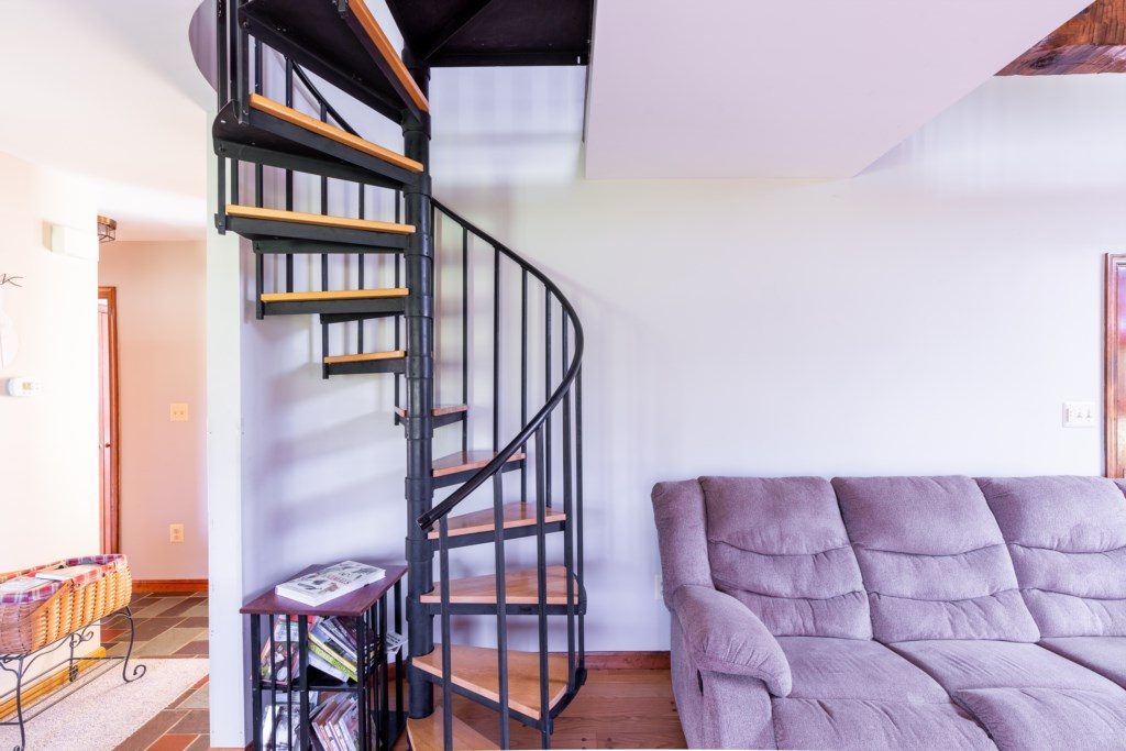 Beautiful spiral staircase leading to the upstairs.