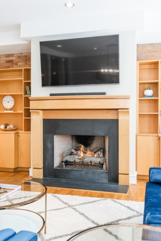 Sit by the Gas Fireplace and watch TV from the 65