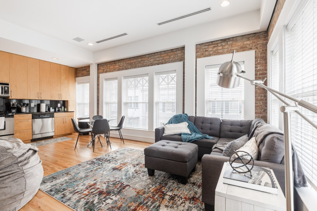 Bright open floor plan with beautiful exposed brick.