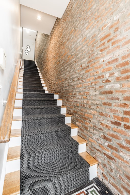 Stairs leading to the apartment entrance to your home away from home