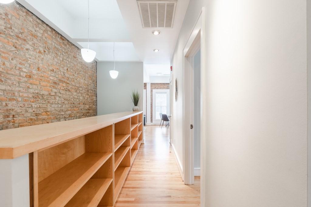 Beautiful HArdwoood Floors Mixed in w Old School Open Bricks