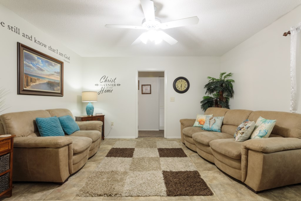 Comfy, plush sofas in the living room for lounging or extra sleeping.