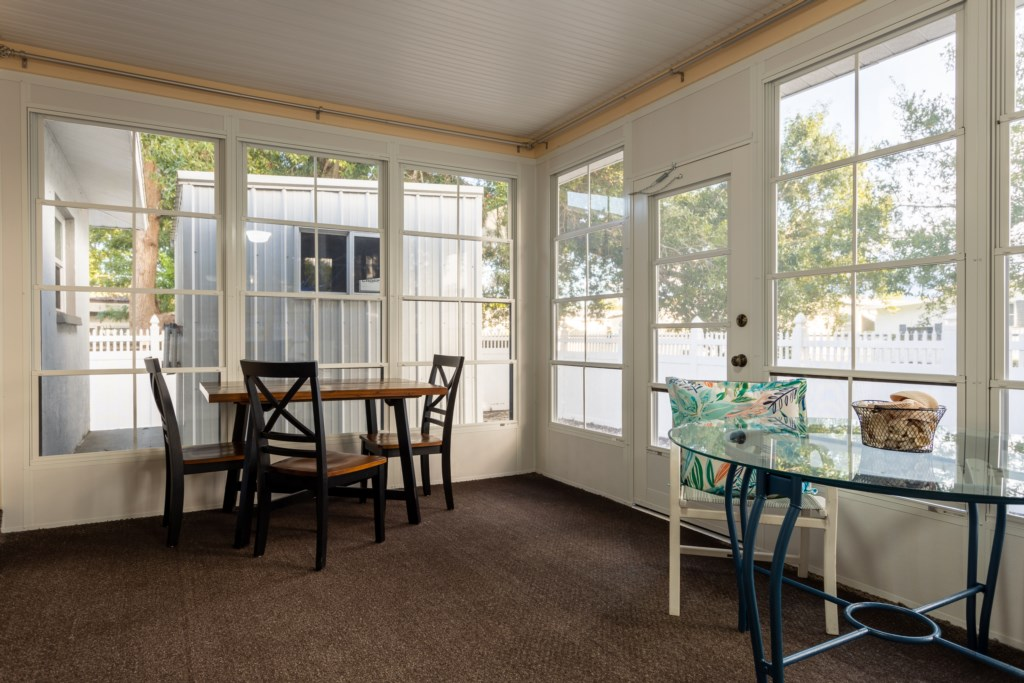 Sunroom with access to the private patio.