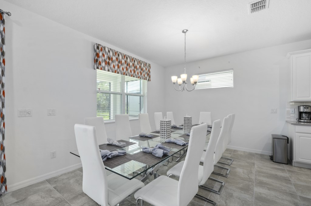 Large dining room table easily seats twelve for meals.