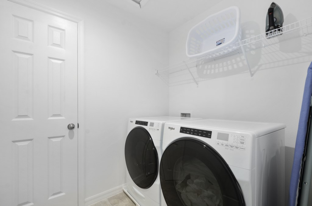 Laundry room stocked with laundry detergent and dryer sheets for your convenience.