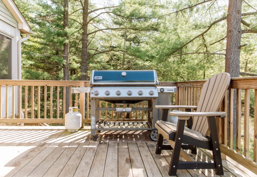 Outdoor propane grill with seating where you can cook for your guests / family