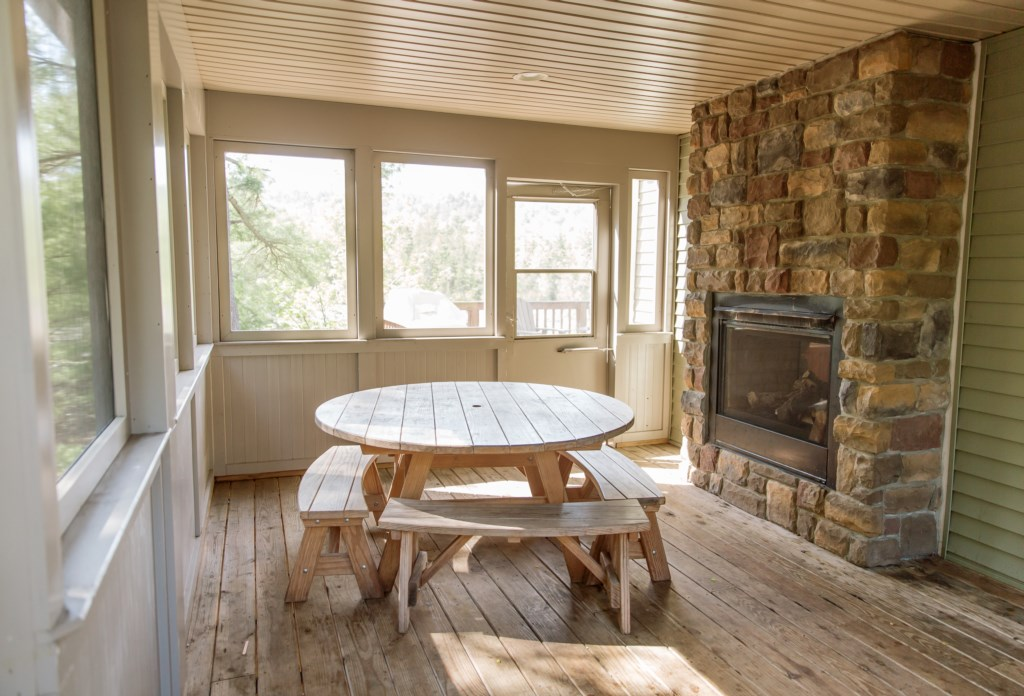 Enjoy extra dining space on the porch, in front of the fireplace.