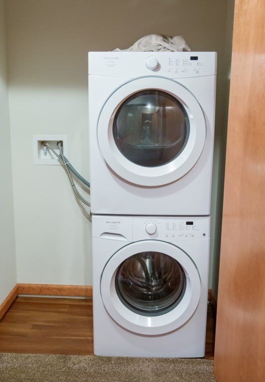 Laundry stocked with laundry detergent and dryer sheets for your convenience.