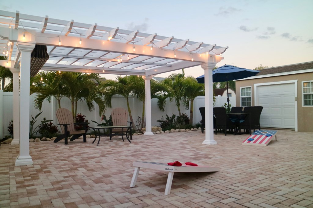 Brand New Pergola just installed with string lights for those beautiful patio nights.