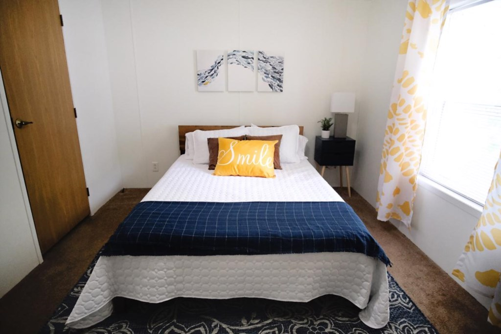 This queen sizes bed in bedroom #2 is sure to make you SMILE!