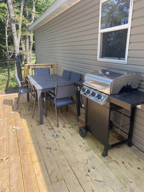 Patio furniture and gas grill provided.