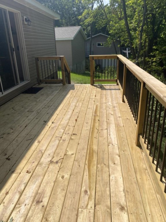 New deck that runs along the whole backside of this cabin has views of lake!
