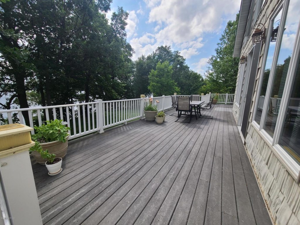 Large lakeside deck with full afternoon sun that will also make for those perfect sunsets in the evening.