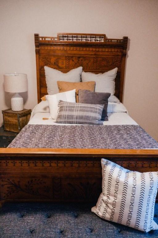 Ornate full bed.
