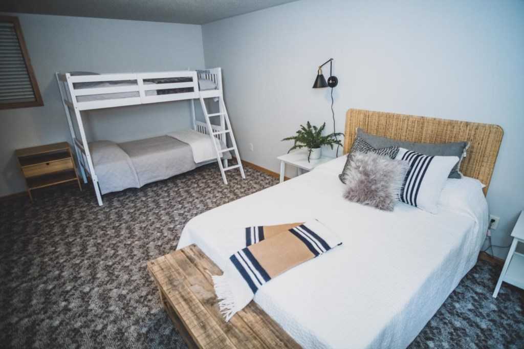 Queen bedroom with bunks for your kiddos.