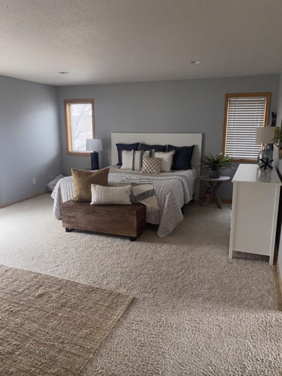 Master upstairs, sliding doors to hot tub and master bath with tub and shower, queen bed.