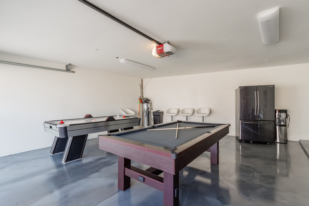 Game room with air hockey table and pool table with a ping pong table to convert it to
