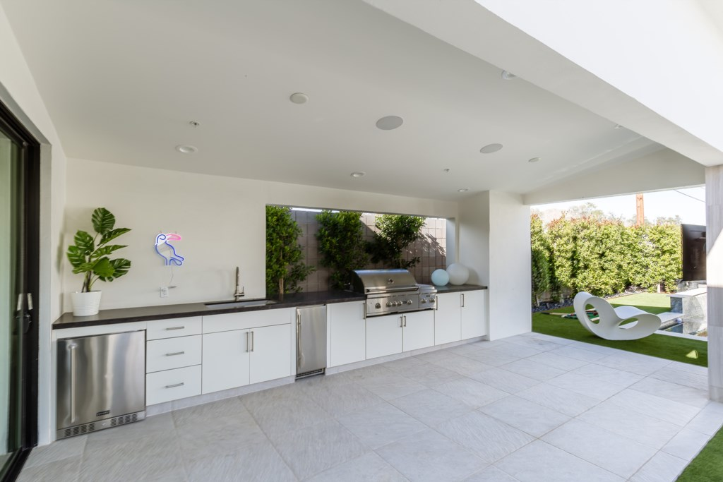 Outdoor grill and dining areas