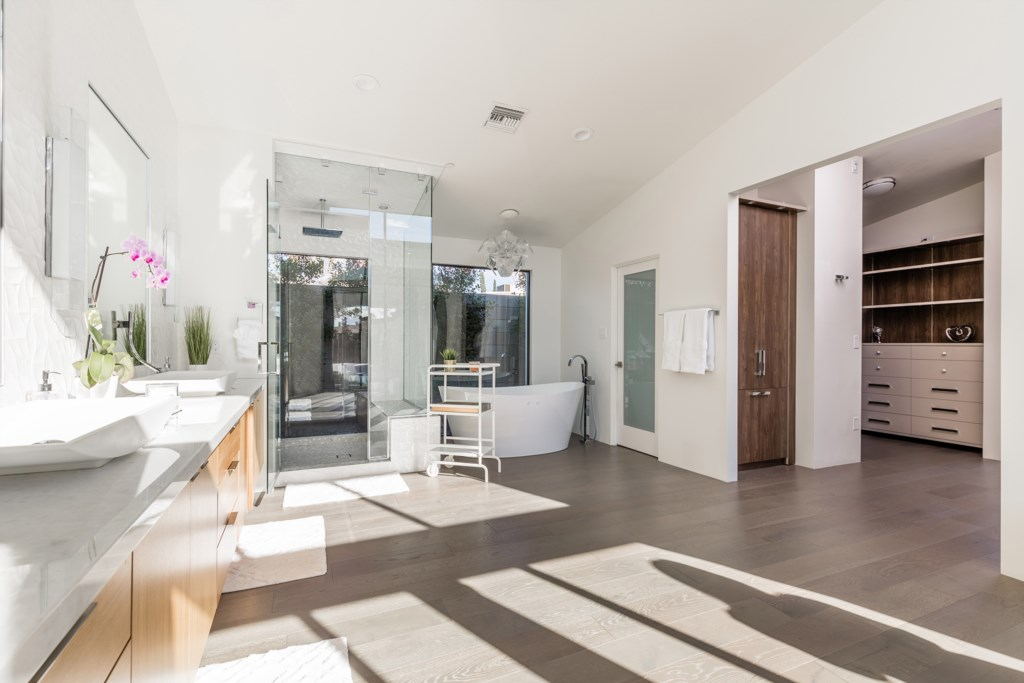Master Bathroom with huge double sink vanity and stand alone tub