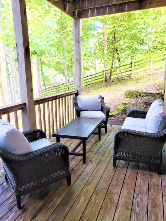 Back porch to watch kids and dogs run around
