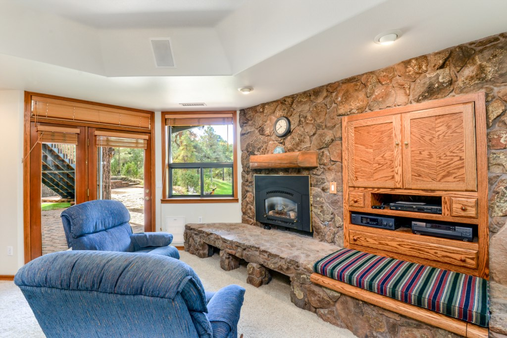 Fire Place and Snowy Views in this Master Bedroom