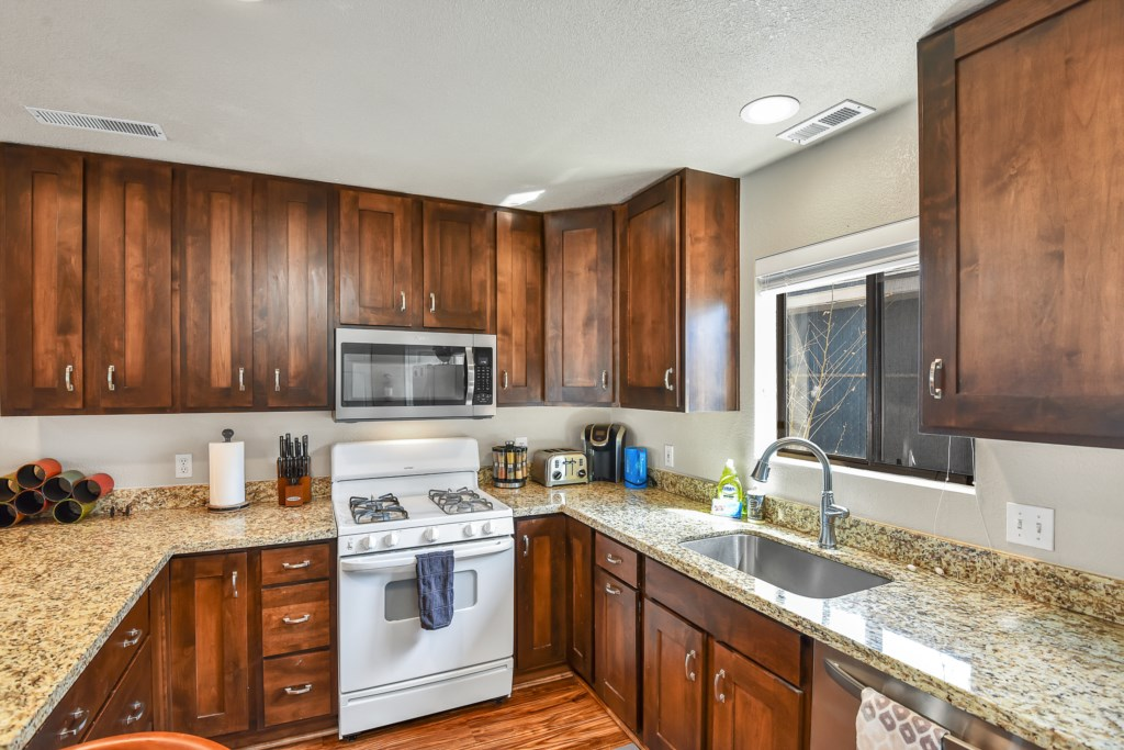 Granite Counters and Wooden Cabinets