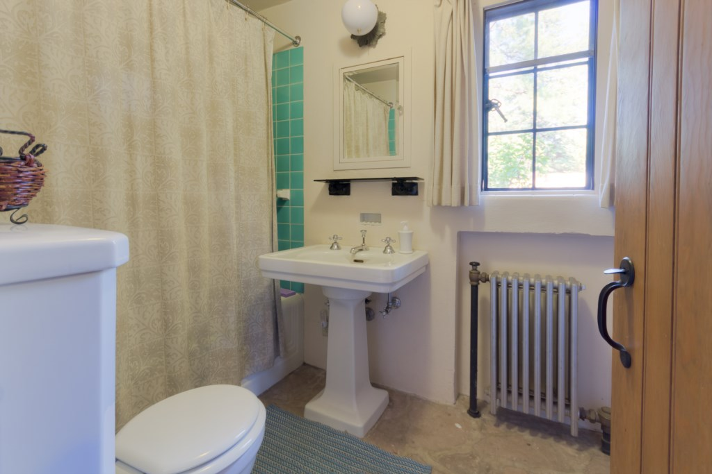 Bathroom with Tub and Teal Tile